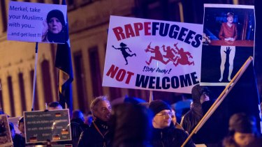 Supporters of  right-wing populist group Pegida march on the first anniversary of its Leipzig affiliate, called Legida, this month  in Leipzig, Germany. Pegida and other right-wing activists have been quick to latch on to the New Year's Eve sex attacks in Cologne.