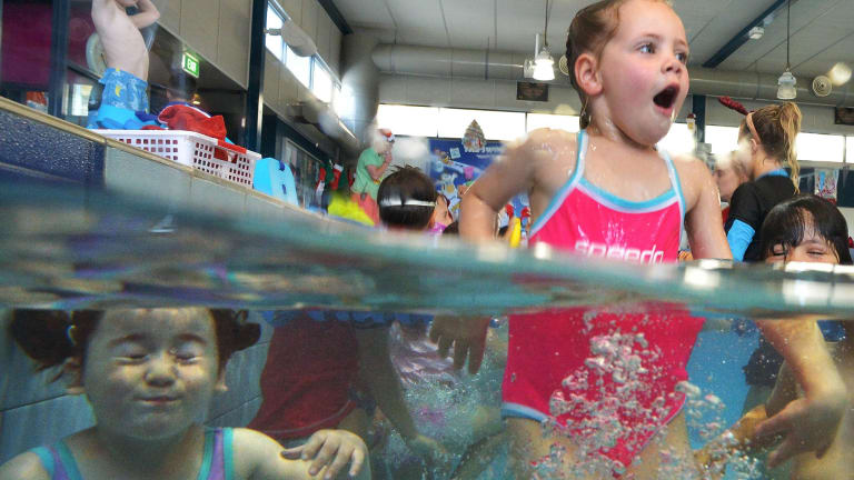 Learning time: Leila Tipping learns to swim at St Bernard's College pool.