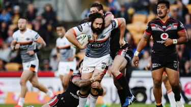Inspirational: Aaron Woods is tackled by Issac Luke and Jacob Lillyman during the round 25 NRL match between the New Zealand Warriors and the Wests Tigers at Mount Smart Stadium.