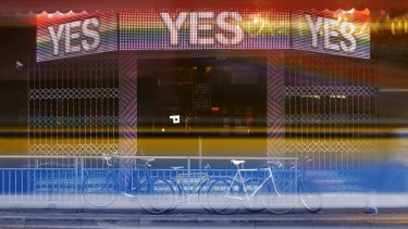 A bus leaves light trails as it passes a bar promoting the 'Yes' vote in central Dublin.