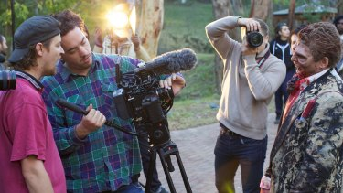 Behind the scenes: On location with <i>Wyrmwood</i> director Kiah Roache-Turner (far left).