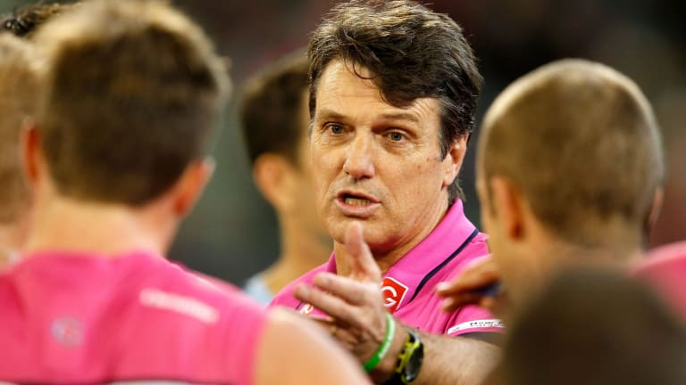Melbourne coach Paul Roos speaks to his players during a break.
