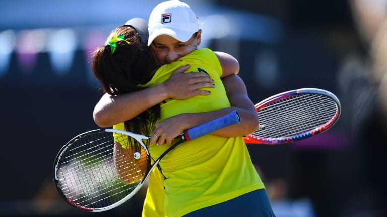 Casey Dellacqua and Ash Barty celebrate their decisive doubles win.