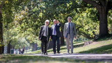 Environment Minister Josh Frydenberg (centre) with Barry Jones (left) and Tom Harley (right) on St Kilda Road on Friday.