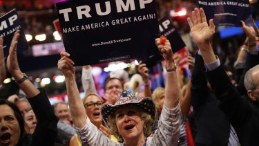Delegates hold campaign signs for Donald Trump.