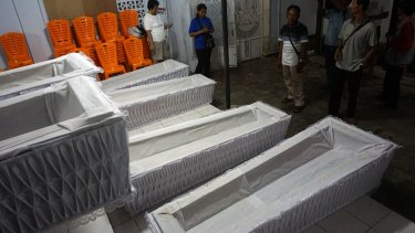 The coffins in the Cilacap police station on Sunday.