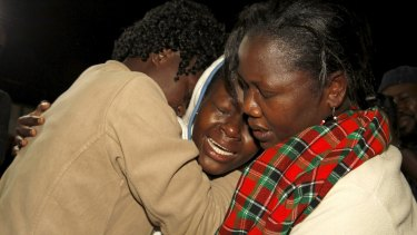 People react after meeting a relative who was rescued after the Garissa University attack.