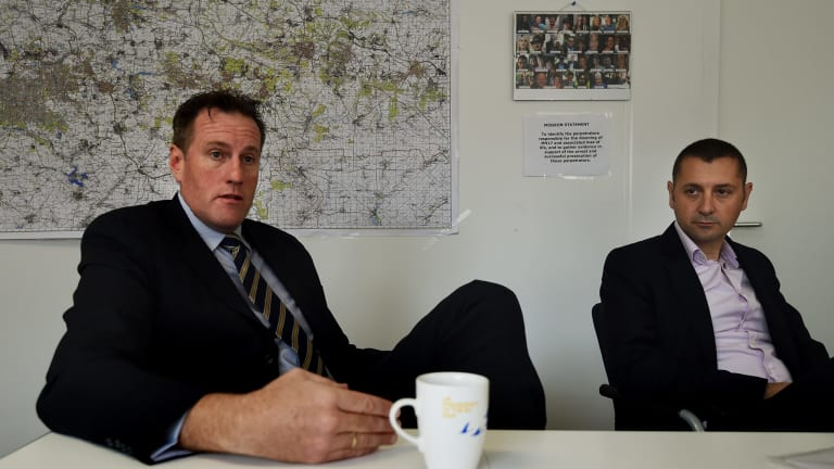 Andrew Donoghoe (left) with AFP Detective Sergeant Julian Bianco in the AFP's office at the Australian Embassy in The Hague.