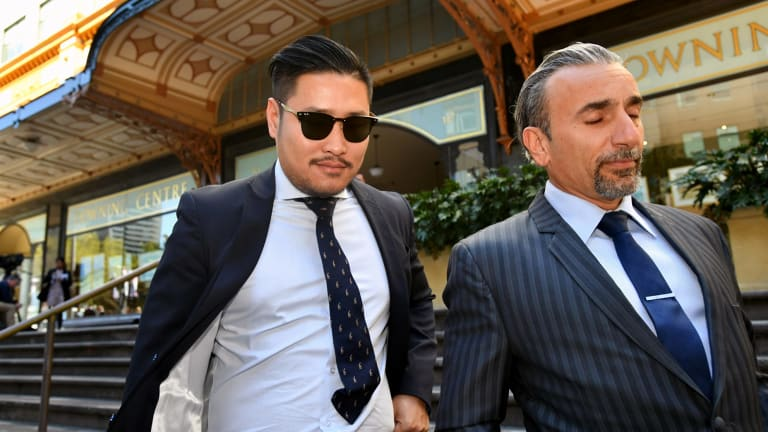 My Kitchen Rules contestant David Vu, left, leaves the Downing Centre Court with his lawyer Robert Daoud in Sydney on Friday.