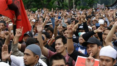 "Indonesian Muslims shout ""Allahu Akbar' (God is great) during a rally to denounce the decree in Jakarta on Tuesday."