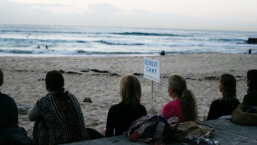 Group meditation at Bondi Beach.