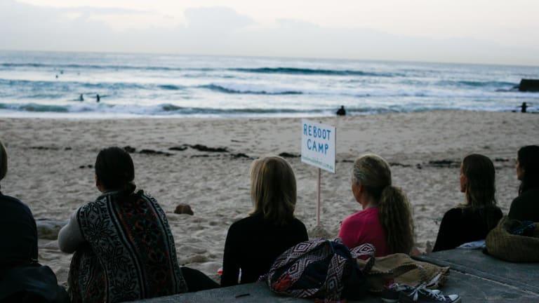 Group meditation at Bondi Beach.