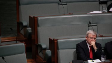 Labor MP Kevin Rudd sits on the backbench during Question Time at Parliament House after his demotion.