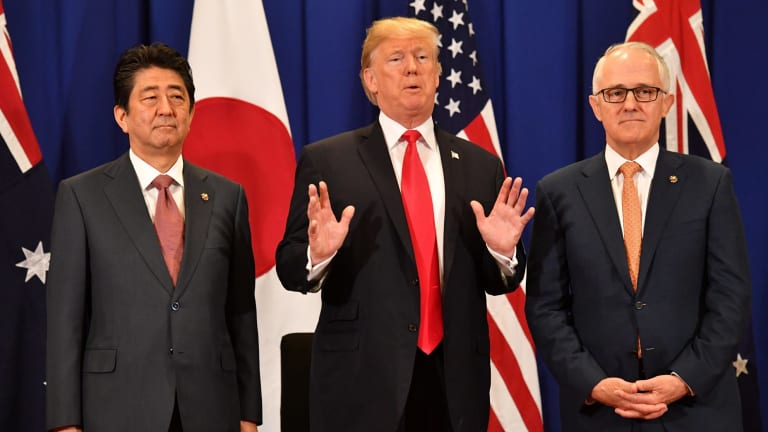 Malcolm Turnbull with US President Donald Trump and Japanese PM Shinzo Abe in Manila in November. China wants us to support their foreign policy objectives and cull us from the US alliance, Kim Beazley says.