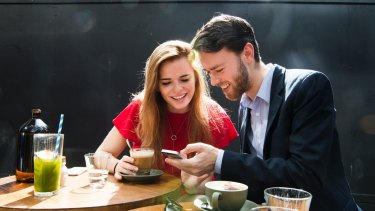 Happy app users: Housemates Kaitlyn Tremblay and Nicholas Phillpott having coffee in Barangaroo.
