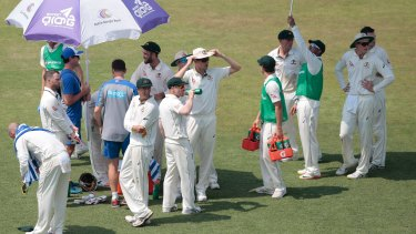 Australian players during a drink break on day one.