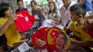 Buying merchandise with pictures of Myanmar opposition leader Aung San Suu Kyi on Tuesday at a shop run by her National League of Democracy party in Yangon.