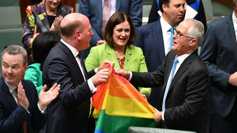 Malcolm Turnbull celebrates with colleagues after the House of Representatives legalised same-sex marriage.