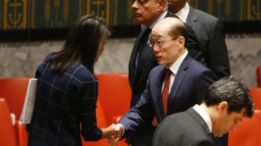 US Ambassador to the US Nikki Haley speaks to China's Ambassador Liu Jieyi after a vote to adopt a new sanctions resolution against North Korea on Monday evening.