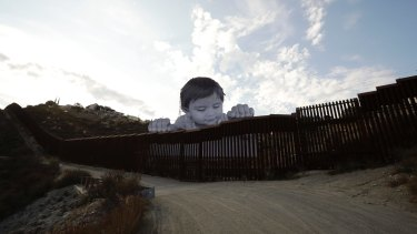 The Mexican boy artwork by French artist JR in Tecate, Mexico, on the Californian border, aims to prompt discussions about immigration.