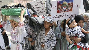 Palestinian children re-enact the Nakba  in the Palestinian refugee camp of Ain al-Hilweh in Lebanon in 2009.