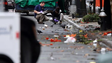 Evidence teams investigate at the scene of Saturday's explosion in Manhattan's Chelsea neighbourhood.