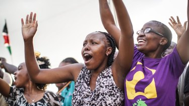 Crowds cheer from the roadside as Pope Francis' convoy drives through the capital from the airport.