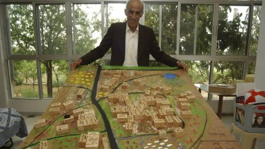 Ahmad Saadi, a Palestinian refugee living in Lebanon, with a model of his home village of Taytaba in the Galilee, which he created from memory. Taytaba was depopulated in 1948 and remains derelict.