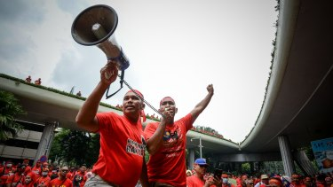 """Pro-government """"red shirt"""" protesters shout slogans during a demonstration in Kuala Lumpur earlier this month."""