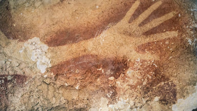 Hand stencils from the Indonesian island of Sulawesi have been dated to at least 40,000 years old.