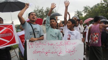 Demonstrators hold banners and shout slogans in protest of the arrival of Kofi Annan in Sittwe, Myanmar.