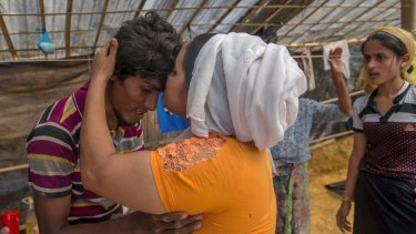 Nunhar Begum, a Rohingya Muslim woman who crossed over two weeks ago from Myanmar, is reunited with her son Nur Karim in Bangladesh, on Friday.