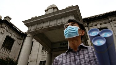 Outside the Bank of Korea museum at the central bank's headquarters in Seoul on Thursday. The Bank of Korea lowered its key interest rate to an unprecedented low as the spread of MERS risks derailing an economic recovery.