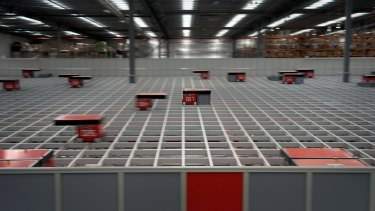 Robots dance above the two-story shafts at the Catch Group's warehouse, picking up and sorting online orders.