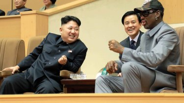 North Korean leader Kim Jong-un, left, talks with former NBA player Dennis Rodman, right, as they watch an exhibition basketball game at an indoor stadium in Pyongyang in 2014.