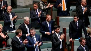Former prime pinister Tony Abbott and former defence minister Kevin Andrews after Treasurer Scott Morrison delivered the budget speech.