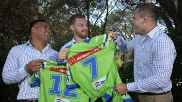 Canberra Raiders players Jeff Lima (left), Elliott Whitehead and Aidan Sezer clown around and swap their team jerseys after a presentation at the Royal Canberra Golf Club.