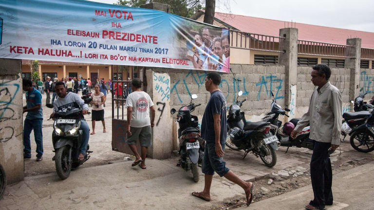 Voters enter a polling booth in Dili, East Timor, on Monday.