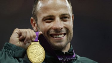 Oscar Pistorius with his Paralympic gold medal from London in 2012.