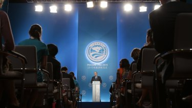 In the spotlight: Russian President Vladimir Putin speaks at a news conference at the summit on Friday.