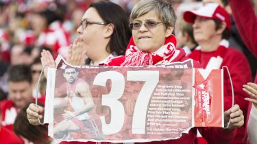 Fans support Adam Goodes with the Fairfax poster.