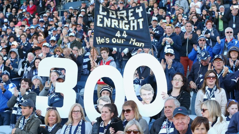 Geelong fans celebrate Corey Enright's 300th game.