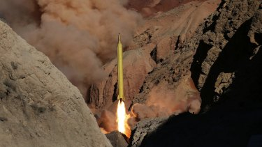 A Qadr H long-range ballistic surface-to-surface missile is fired by Iran's Revolutionary Guard in March 2016. The US has tried to tie resumed sanctions to missile testing - which is not part of the nuclear deal.