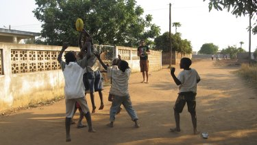 Mozambique has declared itself free of landmines ... Collingwood footballer Harry O'Brien teaches a group of Mozambique boys about Australian Rules football in 2008.