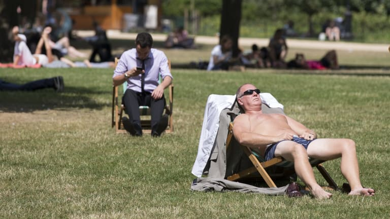 Britons enjoy the warm weather in St James's Park, London.