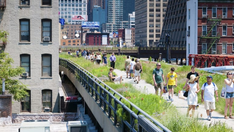People walk the New York High Line, an elevated park along 10th Avenue.