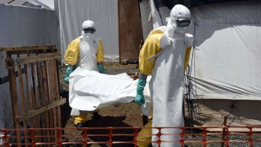 Medical staff carrying the body of an Ebola victim in Monrovia, Liberia, in September last year.