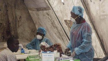 Health workers take blood samples in Sierra Leone in June last year.