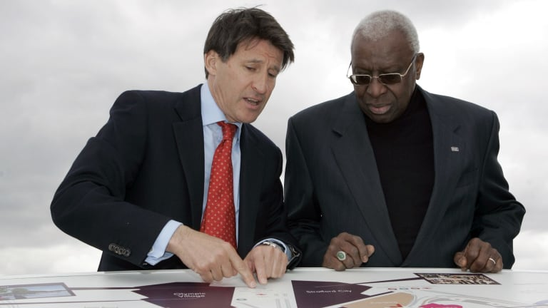 In this May, 2009 file photo current president of the IAAF Sebastian Coe, left, with then president of the IAAF Lamine Diack look at a map of the site of the London 2012 Olympics in London.
