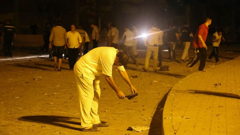 A man takes pictures after the bomb exploded.